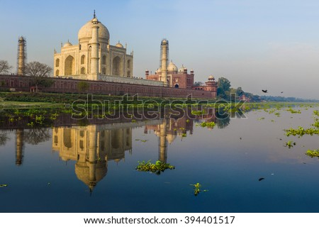 The Taj Mahal View from the boat on the opposite side of the river Yamuna, sunrise time, March 2016. - stock photo