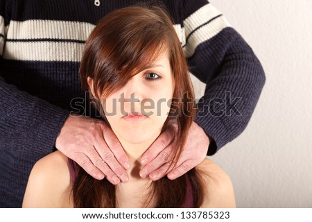 The tall man is touching the little girl - stock photo