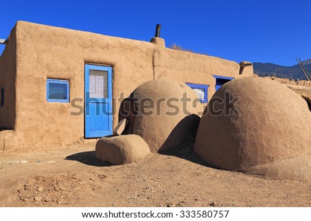 The Taos pueblo in New Mexico features traditional native American kiva fireplaces. - stock photo