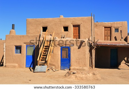 The Taos pueblo in New Mexico is the USA's oldest continuously inhabited community. - stock photo