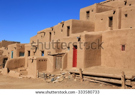 The Taos pueblo, with its colorful doors, is a popular tourist destination in northern New Mexico. - stock photo