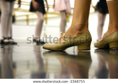 The tap dance teacher leads the kids - stock photo