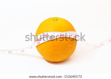 The tape measure of body good health with an orange - stock photo