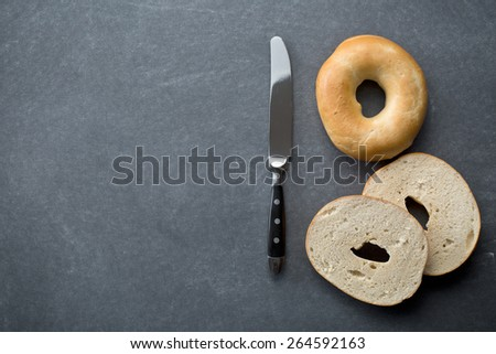 the tasty bagel on chalkboard - stock photo