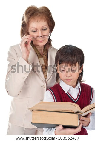 The teacher helps the pupil to understand the text - stock photo
