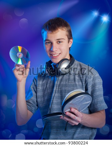 The teenager chooses music on a disk - stock photo