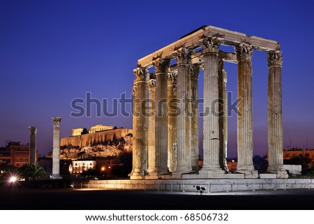 "The Temple of Olympian Zeus (considered one of the biggest of the ancient world) in the ""blue"" hour, with Acropolis in the background - stock photo"