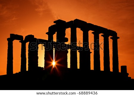 The Temple of Poseidon (ancient God of the Sea), at cape Sounion, at sunset, close to Athens, Attica, Greece - stock photo