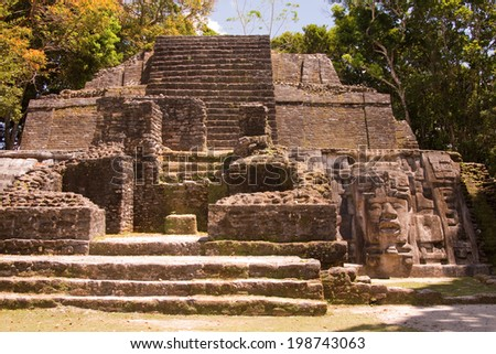 The temple of the mask in the Mayan city of Lamanai in Belize, Central America - stock photo