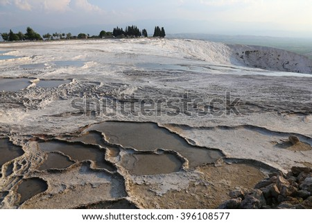 """The terraces of Pamukkale, which means """"cotton castle"""" in Turkish, is natural site in southwest Turkey.  - stock photo"""