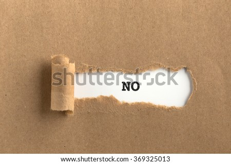 The text NO behind torn brown paper - stock photo
