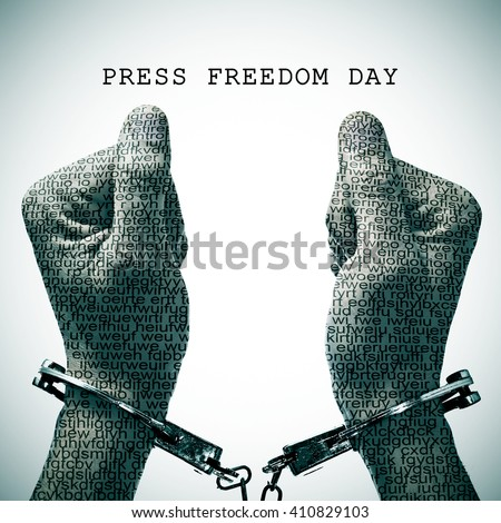 the text press freedom day and a handcuffed man with his hands and wrists patterned with no-sense words - stock photo