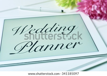 the text wedding planner in the screen of a tablet computer - stock photo