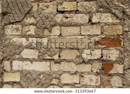 the texture is destroyed brick wall - stock photo