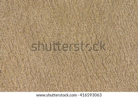 The texture of beach sand - stock photo