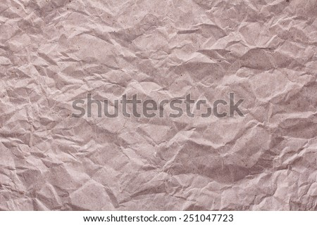 The texture of brown crumpled paper. Green technology, recycling paper. Background, texture of paper. - stock photo