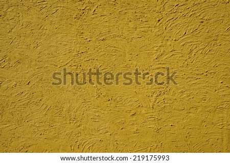 The texture of mustard color walls painted large erratic strokes of pain                                - stock photo
