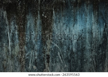 The texture of old concrete green wall closeup - stock photo