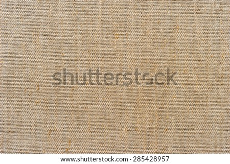 The texture of the burlap, closeup with yellow tint - stock photo