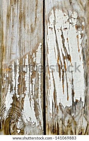 The texture of the old boards with peeling white paint - stock photo