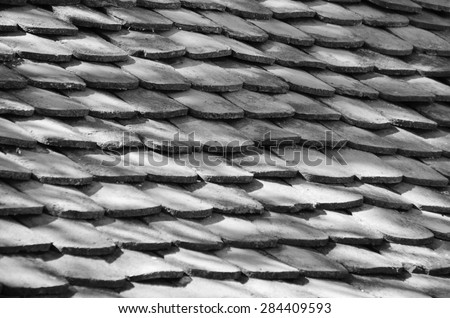 The texture of the old tiles to cover home (black and white) - stock photo