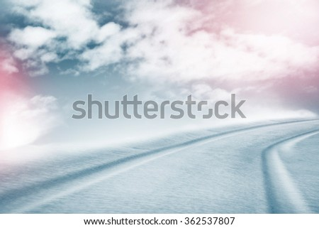 The texture of the snow. Winter background. Snow covered road - stock photo