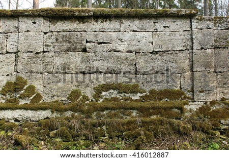 The texture of the stones in blank wall that separates the park from the Sylvia Park Palace, built in the late 18th century. Gatchina, Leningrad, Russia - stock photo