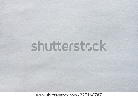 the textured background from synthetic smooth fabric of light tones silvery color - stock photo