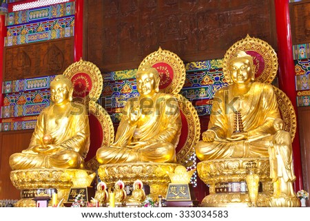 The three Buddhas in the Chinese temple of Thailand - stock photo