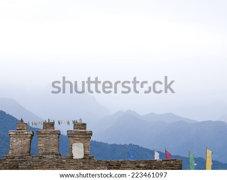 The three chortens with large prayer flags at Sikkims ancient capitol Rabdentse (India) in the Himalayan mountains - stock photo