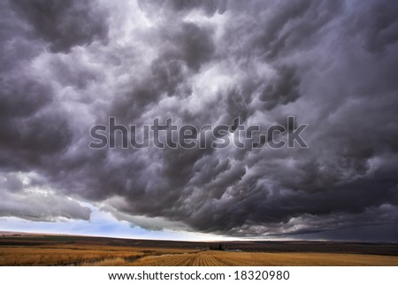 The thundercloud closes the sky above boundless plain in state of Montana. More magnificent pictures from the American and Canadian National parks you can look hundreds in my portfolio. Welcome! - stock photo