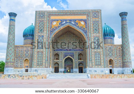 The tiger mosaics on the facade of Sher-Dor Madrasah became the symbol of the country, Samarkand, Uzbekistan. - stock photo