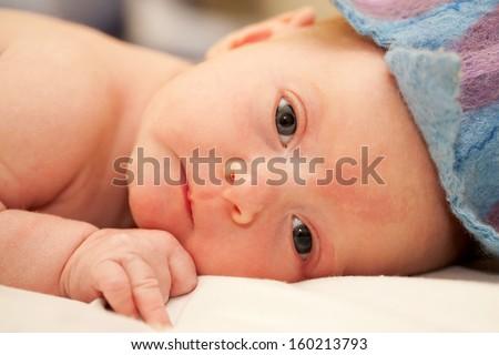 The tiny newborn baby close-up portrait. - stock photo