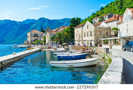 The tiny port in the city centre of Perast makes it even more idyllic and cozy, Montenegro. - stock photo