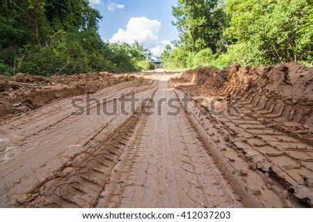 The tire prints at the raw road. - stock photo