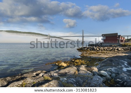 The Tjelsjund bridge that connects the Lofoten to the mainland of Norway. - stock photo