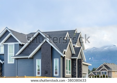 The top of the house with nice window. - stock photo