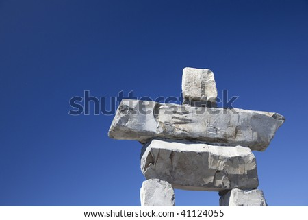 The top of the inukshuk on Whistler Mountain against a clear blue sky. - stock photo