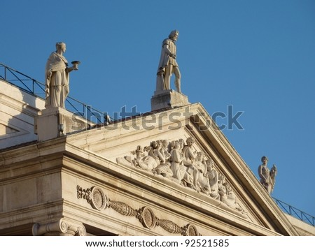 The top of the neo classical front of the national theater Donna Maria II in Lisbon in Portugal - stock photo