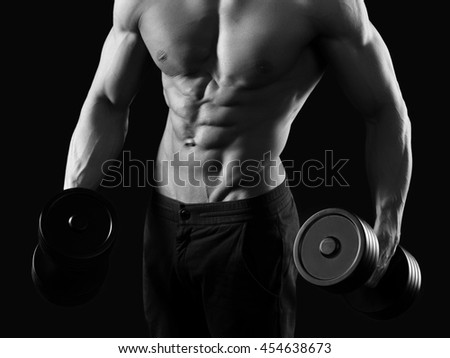 The top shape. Cropped monochrome shot of a fitness man exercising with dumbbells    - stock photo