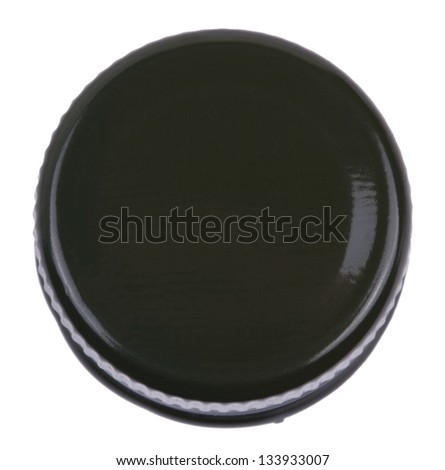 The top side of a green metal bottle cap, seen from a slightly high angle. Isolated on white background. - stock photo