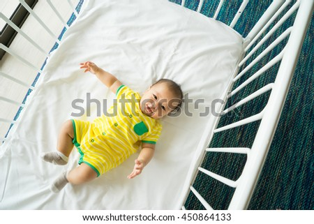 the top view of baby in cot, cradle - stock photo