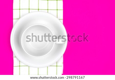 the top view of empty  red dish and towel on vibrant pink color background - stock photo