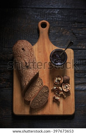 The top view of fruity jam on black wooden table - stock photo