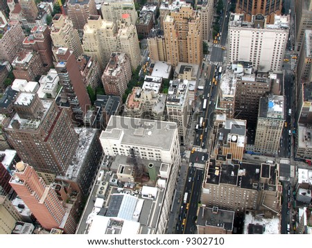 The top view on a mega-city - skyscrapers, roofs, roads, taxi - stock photo