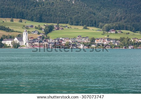 The tourism village St. Wolfgang seen from the opposite bank of Lake Wolfgang in Salzkammergut, Austria - stock photo