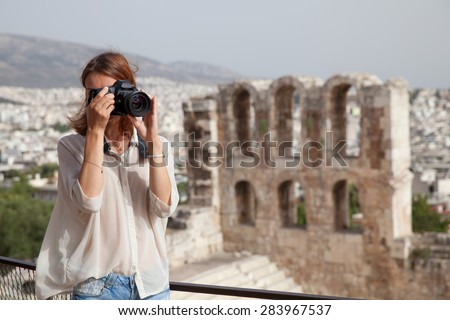 The tourist near the Acropolis of Athens, Greece - stock photo