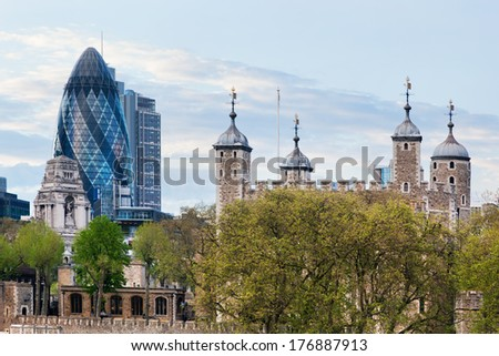 The Tower of London and the 30 St Mary Axe skyscraper aka the Gherkin, England, the UK. The historic Royal Palace and Fortress next to the financial district - stock photo