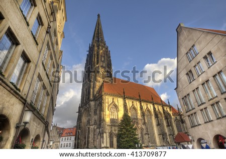 The tower of Saint Lamberti Church in the Prinzipalmarkt street with a Christmas tree in Munster, Germany - stock photo