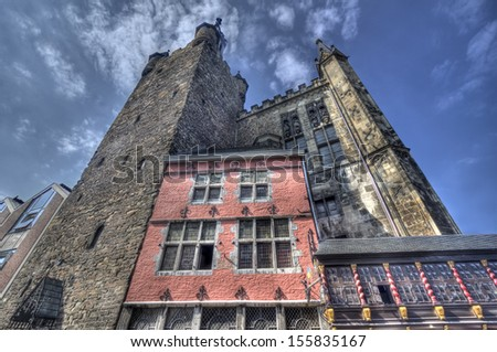 The townhall (Rathaus) of Aachen with tower and blue sky - stock photo